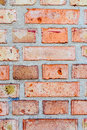 Brick orange red wall. Vertical pattern of building bricks with layers of cement Royalty Free Stock Photo