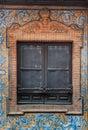 Brick ornament window and balcony spanish style with stucco decoration Royalty Free Stock Photo