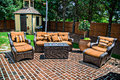 Brick patio and furniture a large matching outdoor Royalty Free Stock Images