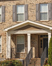 Brick Townhouse with Shutters Royalty Free Stock Photo