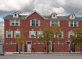 Brick townhouses upscale three story townhouse condominiums in urban setting Royalty Free Stock Photos