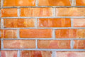 Brick wall background orange textured Stock Photo