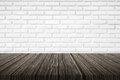 Brick wall background with wood floor Royalty Free Stock Photo