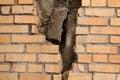 Brick wall with breach Royalty Free Stock Photo