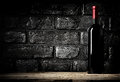 Brick wall and cabernet in cellar bottle of Royalty Free Stock Image