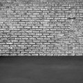 Brick wall and concrete floor black white Stock Photos