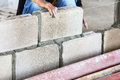 Brick wall construction for house building Royalty Free Stock Photo