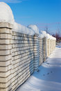 Brick wall, covered with snow in January Royalty Free Stock Image