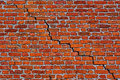 Brick wall with diagonal crack