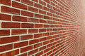 Brick wall with diminishing perspective a red shot close a wide angle lens for a super deep Royalty Free Stock Photo