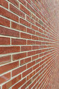 Brick wall with diminishing perspective a red shot close a wide angle lens for a super deep Royalty Free Stock Images