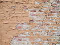 Brick wall with flaking paint detail of old brown Royalty Free Stock Images