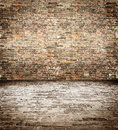 Brick wall and floor of the old to use as a backdrop Royalty Free Stock Photos