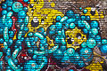 Brick wall graffiti urban over bricks close up Royalty Free Stock Photos