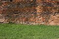 Brick wall with green grass Royalty Free Stock Photo