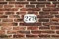 Brick wall with house number Royalty Free Stock Photo