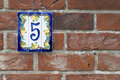 Brick wall with house number plate Royalty Free Stock Photos