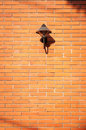 Brick wall with a lamp free space for text Stock Photos