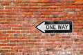 Brick Wall with One Way Sign Royalty Free Stock Photo