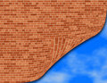 Brick wall over a blue sky Royalty Free Stock Image