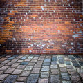 Brick wall and patio Stock Photos