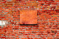 Brick wall with plate Stock Photography