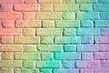 Brick wall rainbow colours on a as a background Stock Image