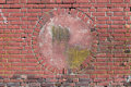 Brick wall of red bricks with a circular alcove in the middle Royalty Free Stock Photo