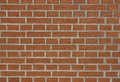 Brick wall of red decorative bricks horizontal closeup Stock Image