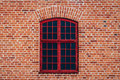 Brick wall with red window Royalty Free Stock Photo