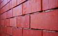 Brick wall rude is not plastered built of red bricks Stock Image