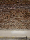 Brick wall and sidewalk Stock Photos