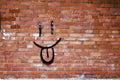 Brick Wall and Smile Graffiti Royalty Free Stock Image