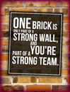 Brick wall with teambuilding phrase Royalty Free Stock Photography