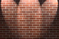 Brick Wall with Three Spotlights Royalty Free Stock Photos