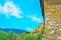 Brick wall in Tuscany on a clear spring day Royalty Free Stock Photo