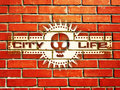 Brick wall with urban life sign