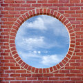 Brick wall window and cloudy sky with round view Royalty Free Stock Photos