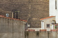 Brick Wall Without Windows With Satellite Dishes On Foreground Royalty Free Stock Photo