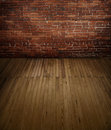 Brick wall with wooden floor an old chicago red a plank Royalty Free Stock Image
