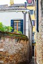 Brick walls between buildings through the city of Venice in Italy
