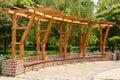 Brick wood pergola in a city park
