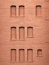 Bricked-in windows on a brick wall Stock Image