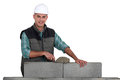 Bricklayer constructing wall a block Royalty Free Stock Photography