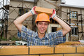 Bricklayer(mason) and bricks Royalty Free Stock Photography