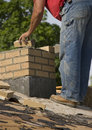 Bricklayer Mason Laying Chimney Bricks on House Royalty Free Stock Photo