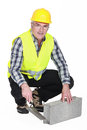 Bricklayer in a reflective vest Royalty Free Stock Photos