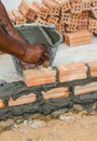 Bricklayer in site builder laying bricks Stock Photo