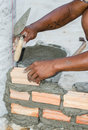 Bricklayer in site builder laying bricks Royalty Free Stock Images