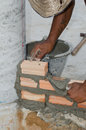 Bricklayer in site builder laying bricks Royalty Free Stock Photo